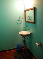 Cleos Agonda - The bathroom of a Kerala-style beach hut at Cleos Agonda in Agonda Beach, Goa