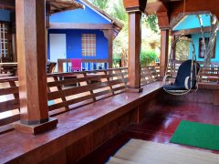 Cleos Agonda - The balcony of a Kerala-style villa at Cleos Agonda in Agonda Beach, Goa