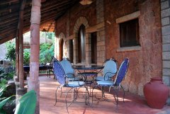 Bhakti Kutir  The spacious verandah of a cabana at Bhakti Kutir in Colomb Bay, Goa