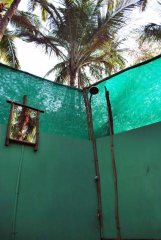 Bhakti Kutir  - The shower of an open-air bathroom attached to a cabana at Bhakti Kutir in Colomb Bay, Goa