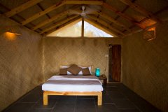 Surya Cafe and Huts Beachfront Hut Bedroom -