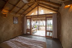 Surya Cafe and Huts Beachfront Hut Bedroom View